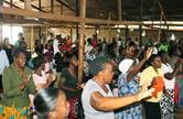 The congregation of Glen-View East United Methodist Church celebrates in worship at the Tichagarika Shopping Center in Harare, Zimbabwe. The church holds lunch-hour services at the market on Wednesdays and Saturdays. Photo by the Rev. Taurai Emmanuel Maforo, UM News.
