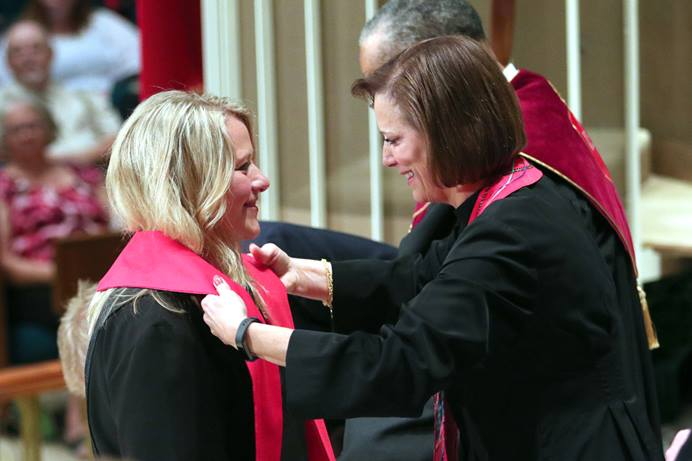 Tiffany Nagel Monroe (left) receives the stole of an elder from the Rev. Linda Harker during a service of ordination June 1, 2016, at St. Luke's United Methodist Church, in Oklahoma City. A report by the Ministry Study Commission about the future of the ordination ministry was presented during the pre-General Conference 2020 briefing held Jan. 23-24 in Nashville. File photo by Hugh W. Scott, Oklahoma Conference.