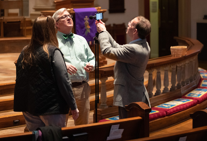 Volunteer Mike Graves (right) prepares to livestream the 10:30 a.m. worship service at Belmont United Methodist Church in Nashville, Tenn., Sunday, March 15, 2020. Church leadership encouraged people to worship from home via the livestream in response to the coronavirus. Helping prepare are Cindy Caldwell (left) and the Rev. Paul Purdue, Belmont's senior pastor. Photo by Mike DuBose, UM News.