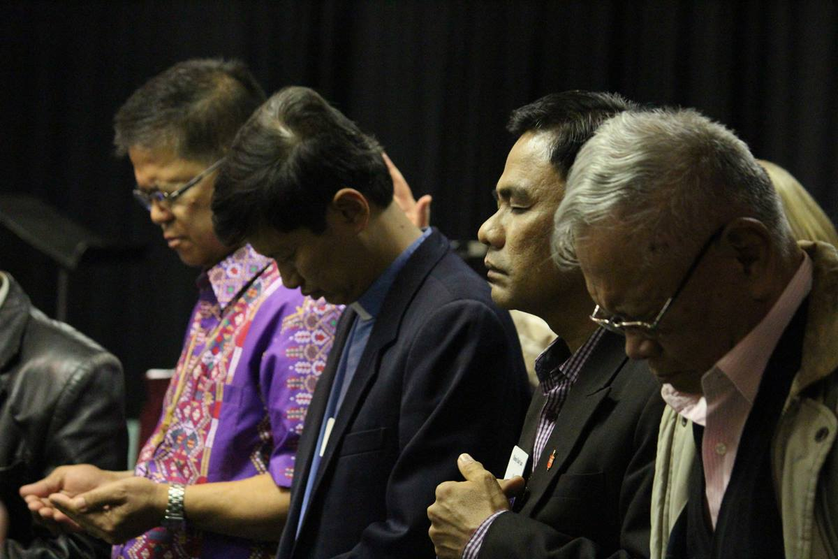 Filipino bishops Ciriaco Q. Francisco (from left), Pedro Torio Jr., Rodolfo A. Juan and Emerito Nacpil (retired) pray during a 2013 meeting of the Council of Bishops. In response to the coronavirus, the active bishops postponed 17 annual conferences in the Philippines indefinitely. File photo by Andrew Jensen.