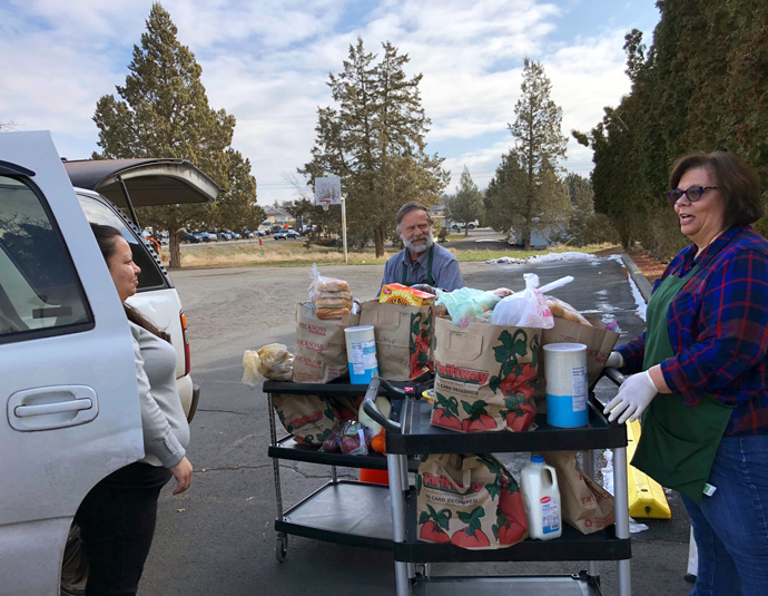 With gatherings limited due to the coronavirus outbreak, Madras United Methodist Church, in Madras, Oregon, shifted to drive-thru pickup for the community food pantry it houses. Photo courtesy of Madras United Methodist Church.