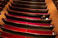 "Susan Logan worships in an empty pew section at Belmont United Methodist Church in Nashville, Tenn., Sunday, March 15, 2020, after church leadership encouraged people to worship from home via video livestream in response to the coronavirus. In keeping with the Metropolitan Nashville mayor's ""Safer at Home"" directive, the church building has since been closed. Photo by Mike DuBose, UM News."