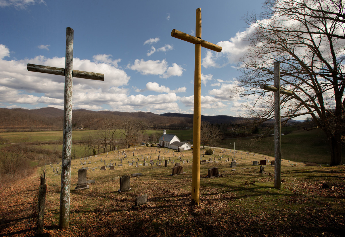 Three crosses stand above the cemetery at Israel United Methodist Church near Montrose, W.Va. This year, United Methodist churches are having to show extra creativity in observing Easter and all of Holy Week because of closed buildings and other restrictions brought on by the COVID-19 pandemic. Photo by Mike DuBose, UM News.
