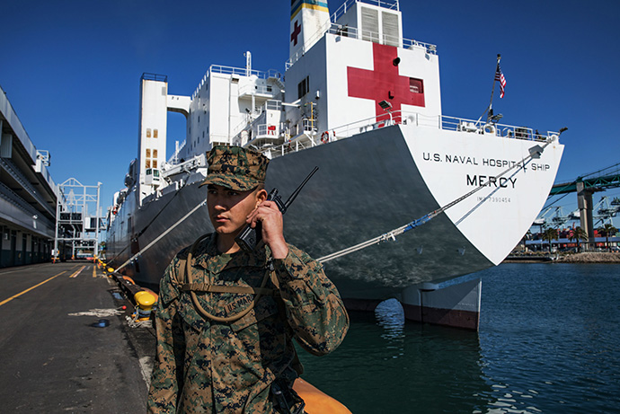 U.S. Marine Corps Pfc. Arnoldo Romero Velazco helps guard the hospital ship USNS Mercy in Los Angeles, where it has been deployed in support of the nation's COVID-19 response efforts. California Gov. Gavin Newsom spoke of the need for religious communities to support the state's shelter-in-place order during a conference call with religious leaders. Photo by Cpl. Alexa M. Hernandez, U.S. Marine Corps.