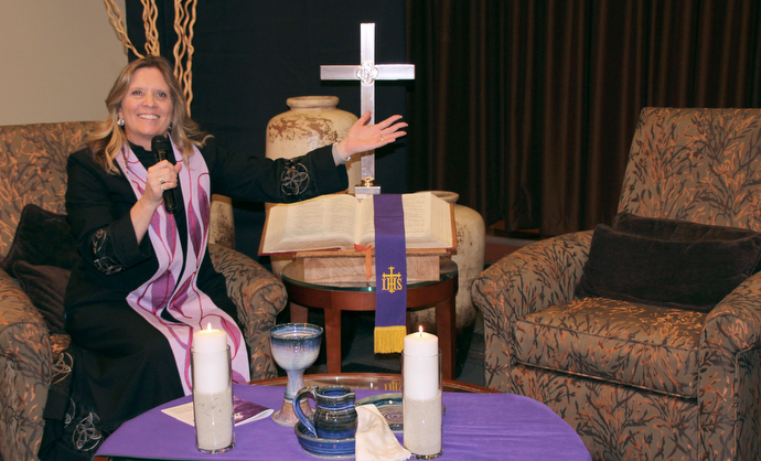 The Rev. Kellie Sanford leads a worship service by closed circuit television at the CC Young Senior Living facility in Dallas. Photo by Jennifer Griffin.