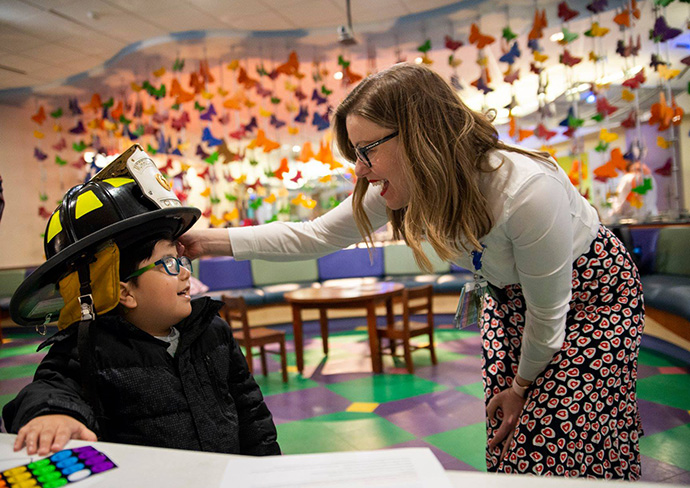The Rev. Amanda Borchik visits with a young patient at Monroe Carell Jr. Children's Hospital at Vanderbilt in Nashville, Tenn. Borchik is staff chaplain at the facility. Photo by Cayce Long.