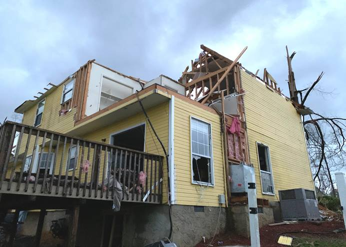 "The Farleys, members of First-Centenary United Methodist Church in Chattanooga, Tenn., posted ""messages of distress"" to their Facebook page after severe storms devastated their home on April 12. Troy Hamilton, youth pastor at the church, drove and then walked to reach them: ""It was glorious to have a familiar friendly face show up."" Photo by Troy Hamilton."