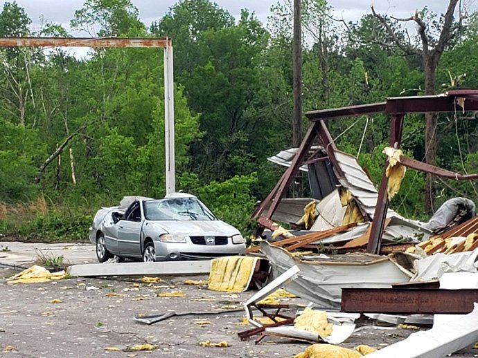 The remains of a structure and a car in Sumiton, Ala., bear witness to the devastation wreaked by a line of storms that traveled across the southern U.S. April 12. Photo by the Rev Billy Weems, Aldersgate United Methodist Church.