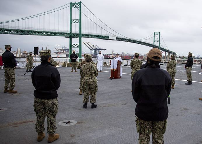 Lt. Cmdr. Genevieve Clark, chaplain, conducts an Easter sunrise service on the flight deck of the hospital ship USNS Mercy in Los Angeles, where it has been deployed in support of the nation's COVID-19 response. Clark is an elder in the Pacific Northwest Conference of The United Methodist Church. U.S. Navy photo by Mass Communication Specialist 2nd Class Ryan M. Breeden.