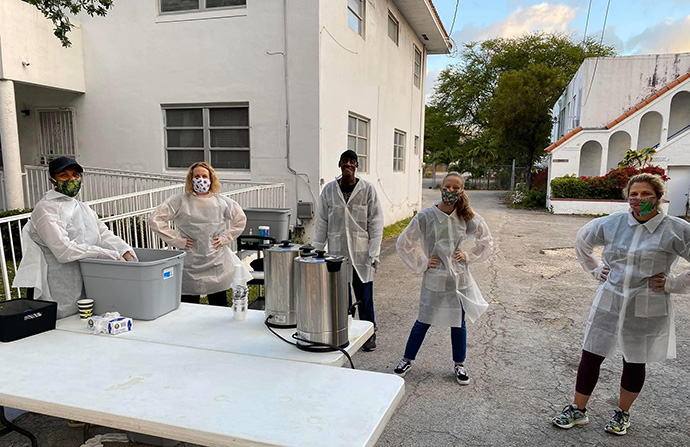 Volunteers from First United Church of Miami keep their distance from each other as they prepare to serve coffee and breakfast to people who are homeless. Photo by Kipp Nelson, First United Church of Miami.