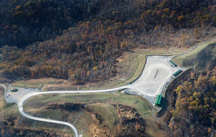A well pad for a hydraulically fractured gas well lies at the end of a gravel access road near Plum Run, W.Va. Aerial photography flight courtesy of SouthWings.
