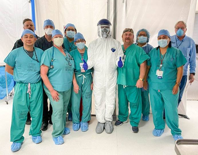 The emergency medical team at Shiprock Indian Hospital in Shiprock, New Mexico, models the Tyvek suits and N95 masks donated by the Desert Southwest Conference's Early Response Team. The hospital serves the Navajo Nation, which has more than 1,100 confirmed COVID-19 cases. Photo courtesy of Gail Ringelberg.