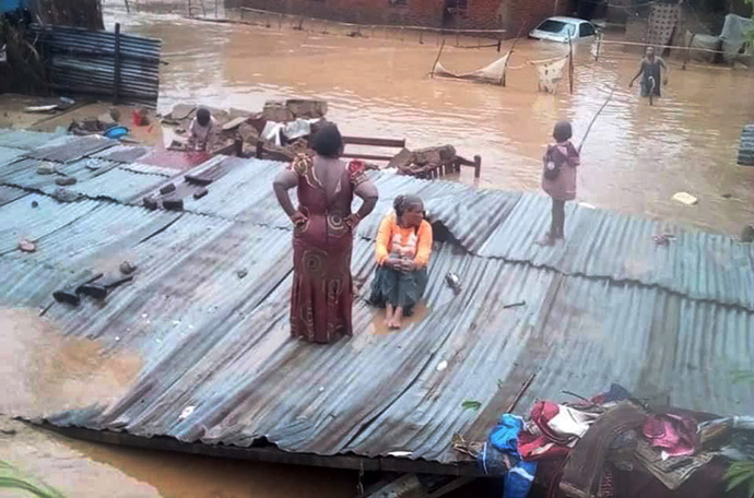 Chantal Bwanga, president of United Methodist Women in Uvira, Congo, was forced to climb onto a roof to escape the flooding. Photo courtesy of Dr. Claude Watukalusu.
