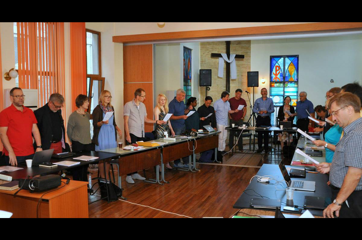 Participants in the European Methodist Council's September meeting in Ruse, Bulgaria, during devotions. Much of the meeting was devoted to a discussion of the current refugee crisis in Europe. Photo by Üllas Tankler, UMNS.