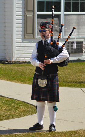 Wyatt Clarke, in full regalia, plays bagpipes around his Marysville, Michigan, neighborhood for residents either shut-in or self-isolating during the COVID-19 pandemic. Photo courtesy of Marysville United Methodist Church.