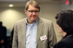 The Rev. Brian Milford (left) talks with Barbara A. Boigegrain during the Connectional Table meeting held at United Methodist Discipleship Ministries in Nashville, Tenn., April 2, 2019. File photo by Kathleen Barry, UM News.