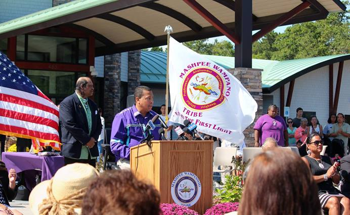 In this 2014 photo, Mashpee Wampanoag Tribal Chairman Cedric Cromwell speaks at the opening of the Mashpee Wampanoag Tribal Community and Government Center in Mashpee, Massachusetts. On March 27, the U.S. Department of the Interior ordered the removal of 321 acres of the tribe's land out of federal trust. Photo courtesy of the Mashpee Wampanoag Tribe.