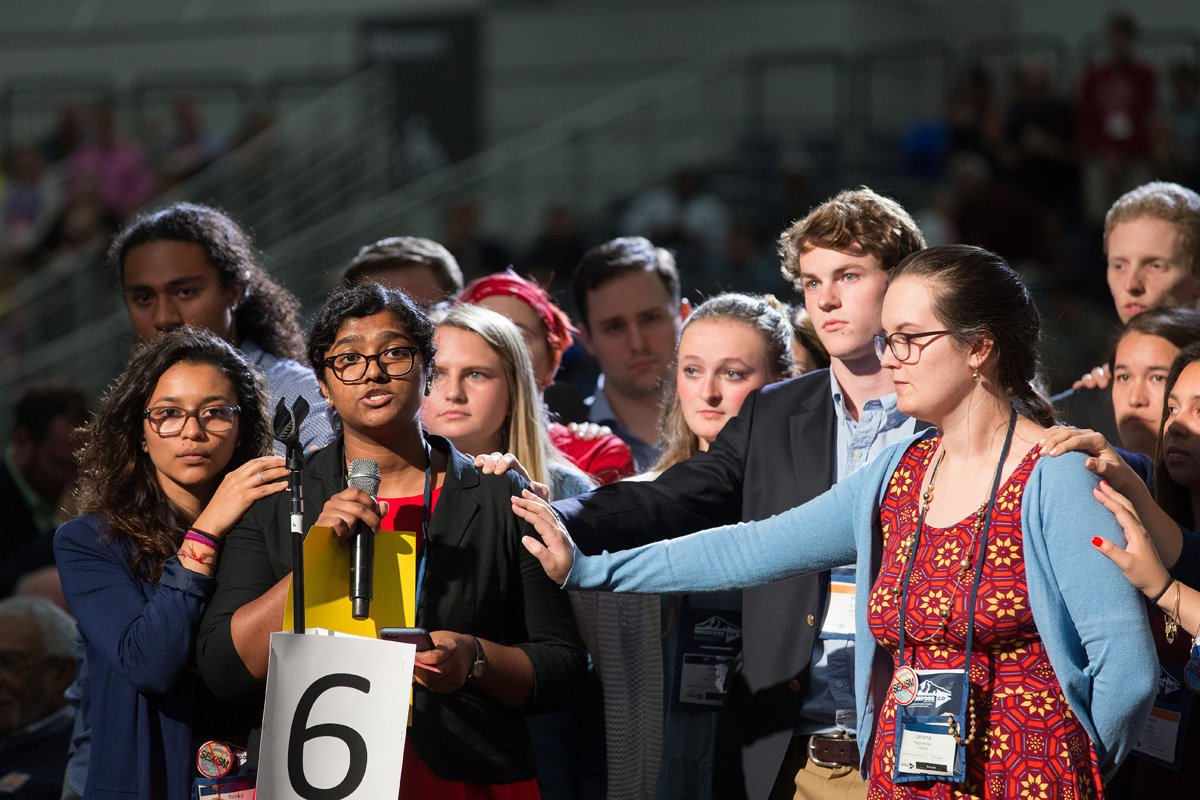 Ann Jacob of the Eastern Pennsylvania Conference is surrounded by other young people as she reads a statement on church unity at the 2016 United Methodist General Conference in Portland, Ore. She is among authors of a petition urging General Conference organizers to reconsider rescheduling General Conference at the start of the academic calendar. File photo by Mike DuBose, UM News.