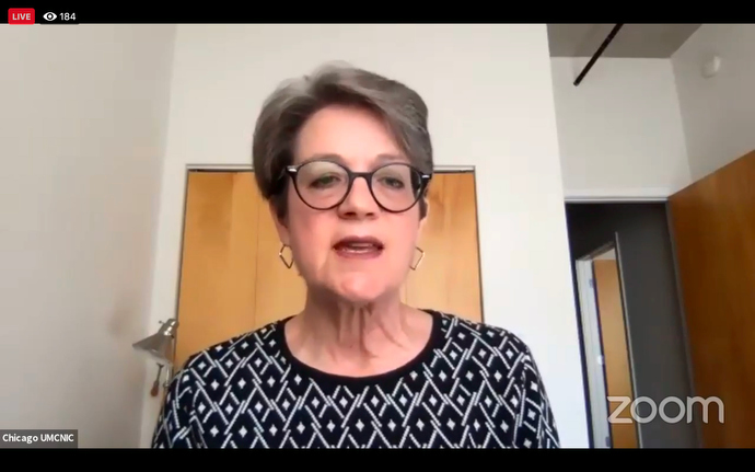 Bishop Sally Dyck reminds fellow bishops that COVID-19 is exacerbating problems in the U.S. and beyond its borders during an online meeting. Screenshot of Zoom meeting via Facebook by UM News.