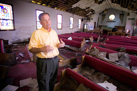 The Rev. Irvin Boudreaux discusses recovery efforts at Brooks United Methodist Church in New Orleans in 2006 nearly a year after Hurricane Katrina. File photo by Mike DuBose, UMNS.