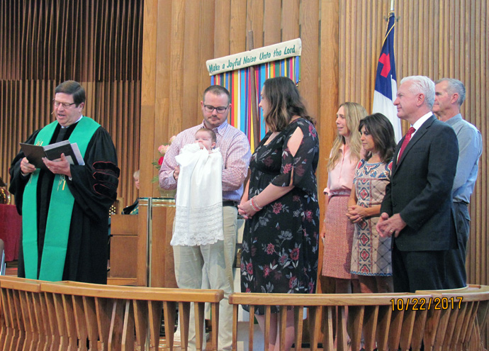 Admiral Brett Giroir and wife Jill Giroir, with other family members, attend the baptism of their first grandchild, a happy event held at Lovers Lane United Methodist Church in Dallas. Brett Giroir, a physician and public health specialist, currently leads the federal effort to expand testing for the coronavirus. He and his wife are counting on being back at Lovers Lane for the baptism of their second grandchild, but it's unclear when that can happen because of coronavirus-related meeting restrictions. Photo courtesy of Jill Giroir.