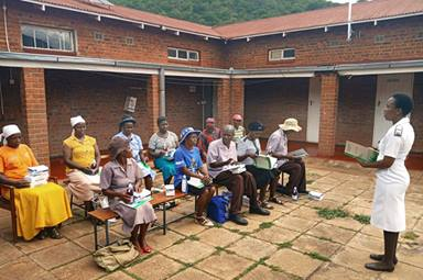 Angela Macherechedze, sister in charge of the family and child health unit at United Methodist Old Mutare Mission Hospital, educates village health workers about the outbreaks of malaria and COVID-19 during training at Old Mutare Mission Hospital in Mutare, Zimbabwe. Photo by Kudzai Chingwe, UM News.
