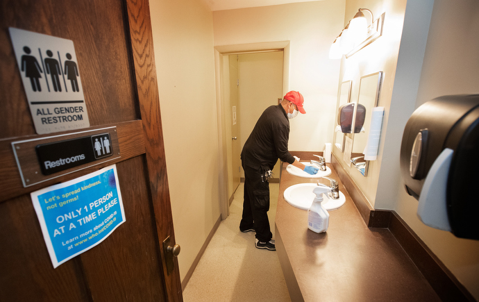 "Custodian James Jimmerson disinfects a bathroom to prevent any possible spread of the coronavirus at Belmont United Methodist Church in Nashville, Tenn., on Sunday, May 10, 2020, after online worship, which was recorded in the sanctuary. ""These bathrooms are the custodians' pride and joy,"" he said. Photo by Mike DuBose, UM News."