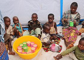 Children eat porridge at United Methodist Irambo Health Center in Bukavu, Congo, during the COVID-19 pandemic. Photo by Philippe Kituka Lolonga, UM News.