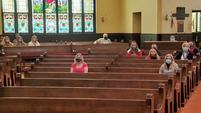 Members of the congregation wear masks and sit apart from one another during worship at First United Methodist Church of Mt. Carmel, Pa., on Sunday, May 10, 2020. Mt. Carmel was able to reopen for in-person worship after guidelines set by state government. Photo courtesy of the Rev. Kay Painter.