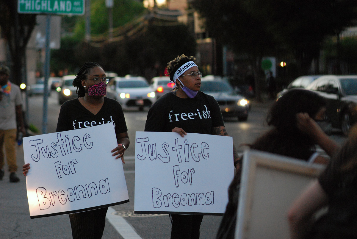 Two women march with signs calling for justice for Breonna Taylor, during protests in Louisville, Kentucky, over the police killings of Taylor in Louisville, George Floyd in Minneapolis, Minn., and other African Americans. Taylor, a 26-year-old emergency room technician, was shot eight times in her bed when officers broke down her door to serve a search warrant. Photo by Cathy Bruce, courtesy of the Kentucky Conference.