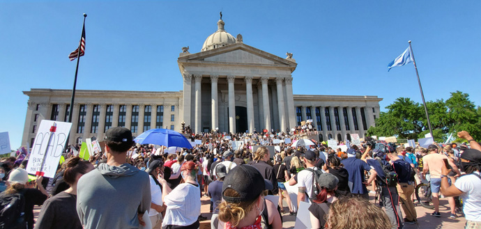 A crowd of protesters gathers outside the capitol building in Oklahoma City, Okla., May 31 for the Demand Justice Rally organized by Black Lives Matter and other organizations in protest of the death of George Floyd, an unarmed African America man in Minneapolis, Minn., and other killings of African Americans by police. The 99th anniversary of the Tulsa Race Massacre was on May 31. Photo by Meagan Ewton, courtesy of the Oklahoma Conference.