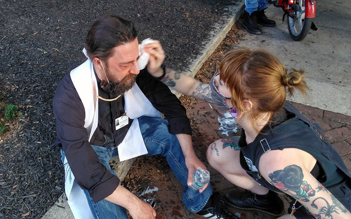 The Rev. Jason Perkowski, a United Methodist pastor, receives assistance after being sprayed with mace during a protest in Lancaster, Pa. Photo courtesy of Jason Perkowski.