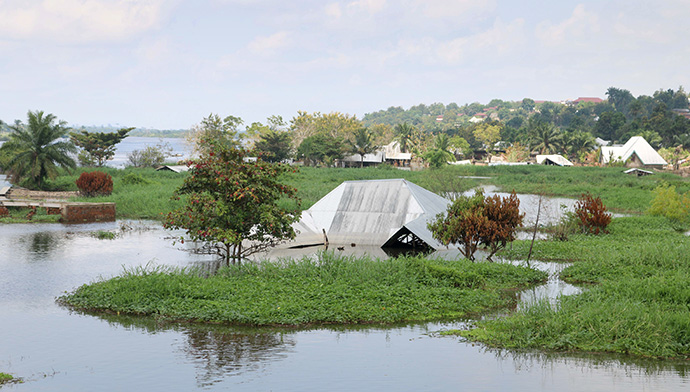 Thousands of homes in Kindu, Congo, were submerged by the waters of the Congo River in April. Although the water has receded, the river is still flooded. The United Methodist Church in Congo has been providing food for flood survivors who have been displaced. Photo by Chadrack Londe, UM News.