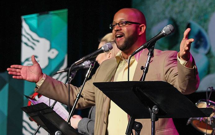"The Rev. R. DeAndre Johnson sings during morning worship at the 2016 United Methodist General Conference in Portland, Ore. Johnson, a delegate to the conference, has written a hymn called ""It Is Enough"" in response to George Floyd's death and earlier tragedies like it. File photo by Maile Bradfield, UM News."