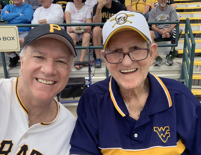 New York Conference Bishop Thomas Bickerton (left)  with his father, Jim Bickerton, at a Pittsburgh Pirate spring training game in Bradenton, Fla., in 2019. Jim Bickerton, 84, contracted the coronavirus in his Florida nursing home/rehabilitation center in mid-April but has lately tested negative for the disease. Photo courtesy of Bishop Bickerton.