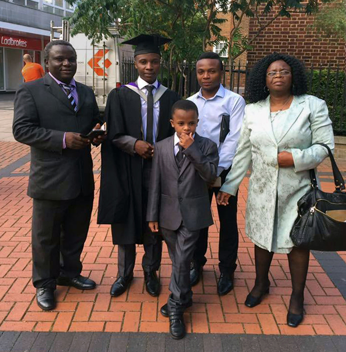 Alice Sarupinda (right) stands with her family for a graduation portrait. Sarupinda, a Zimbabwean and a United Methodist who lived in England, contracted the coronavirus while working at a nursing home in Walsall, England. She died April 17, at age 53. Photo courtesy of the Sarupinda family.