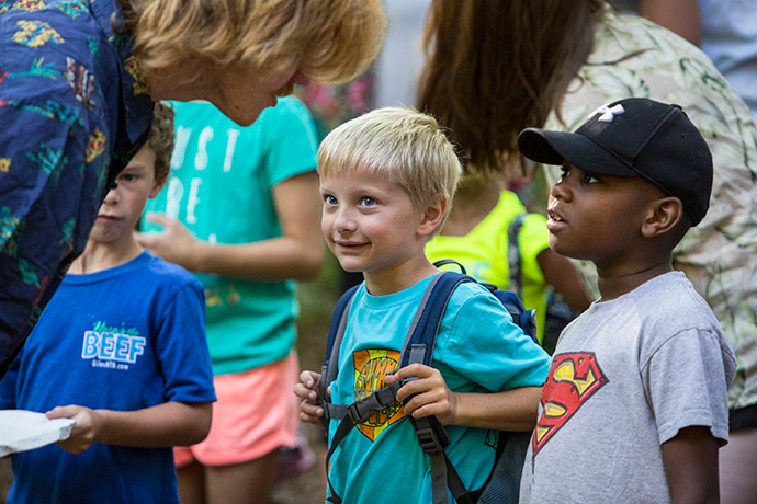 Counselor Jennings Winstead talks with campers Luke Woodard and Jeremy Nkulu at Cedar Crest Camp in Lyles, Tenn., in 2017. Because of COVID-19, Cedar Crest is among many United Methodist camps that have had to cancel this year. File photo by Kathleen Barry, UM News.