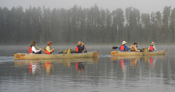 Boy Scouts and leaders from Troop 17 in Nashville, Tenn., paddle through the Turtle River-White Otter Lake Provincial Park near Atikokan, Ont., Canada, in 2012 during a summer program at the Northern Tier High Adventure Base. Most scouting programs have postponed or canceled their 2020 summer camps due to COVID-19. File photo by Mike DuBose, UM News.