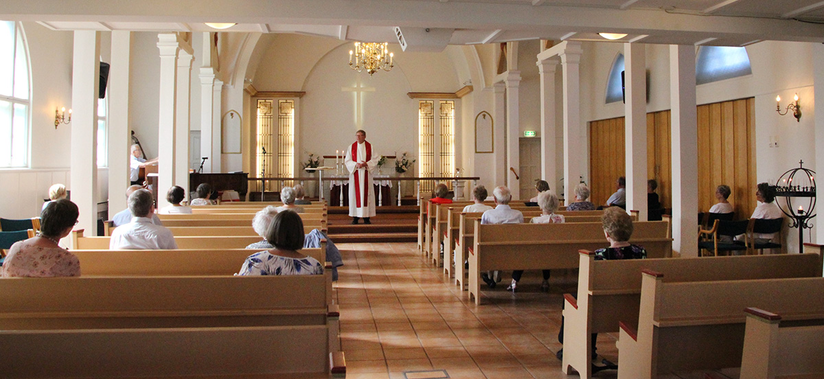 On Pentecost, the congregation of The United Methodist Church Porsgrunn in Norway had to sit apart, using every second pew. Only 50 people were admitted for worship because of the threat of the coronavirus. Photo courtesy of The United Methodist Church Porsgrunn.