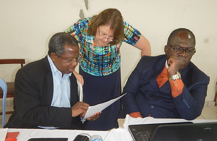 Yed Esaie Angoran (left) helps lead a writing workshop in Abidjan, Côte d'Ivoire, in 2015. Angoran, who died June 13, served on the board of many United Methodist agencies. With him are Robin Pippin of Discipleship Resources (center) and the Rev. Philippe Adjobi. File photo by Isaac Broune, UM News.