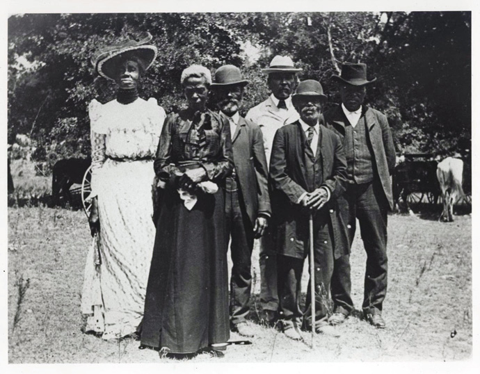 Historic image of a Juneteenth Emancipation Day Celebration, June 19, 1900, Texas, from The Portal to Texas History Austin History Center, Austin Public Library. Although the Emancipation Proclamation was issued more than two years prior, the holiday celebrates the reading of federal orders on June 19, 1865 in Galveston, Texas, one of the remote areas of slavery where enforcement had been slow and inconsistent. Photo by Mrs. Charles Stephenson (Grace Murray), courtesy of Wikimedia Commons.