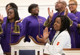 Bishop Cynthia Moore-Koikoi sings with members of the Anointed Voices choir at Ben Hill United Methodist Church in Atlanta where members of Black Methodists for Church Renewal worshipped during their 2019 meeting. Moore-Koikoi is part of a churchwide campaign to dismantle racism. File photo by Mike DuBose, UM News.