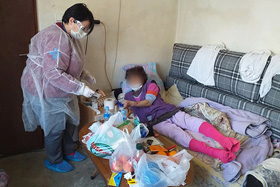 An employee from the Home Care Ministry of The United Methodist Church in Macedonia checks on the welfare of a client at her home in Strumica. The client's face was blurred to protect her privacy in this photo provided by the Home Care Ministry. Photo courtesy of The United Methodist Church in Macedonia.