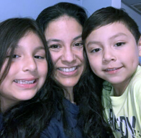 Claudia Marchan (center), executive director for North Illinois Justice for Our Neighbors, with her daughter Ximena, and son Enrique. Marchan is a DACA recipient. Photo courtesy of Justice for Our Neighbors website.