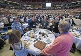 Delegates hold hands and pray during the Feb. 23, 2019, opening plenary of the special session of General Conference held in St. Louis. File photo by Paul Jeffrey, UM News.