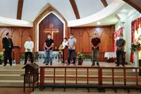 The Rev. Noel Alfonso honors fathers during a Father's Day service June 21 at Munoz United Methodist Church in Nueva Ecija, Philippines. Churches in North and South Cotabato in Mindanao and Nueva Ecija in Luzon were among those allowed to reopen under modified guidelines to stop the spread of the coronavirus. Photo courtesy of the Rev. Noel Alfonso.