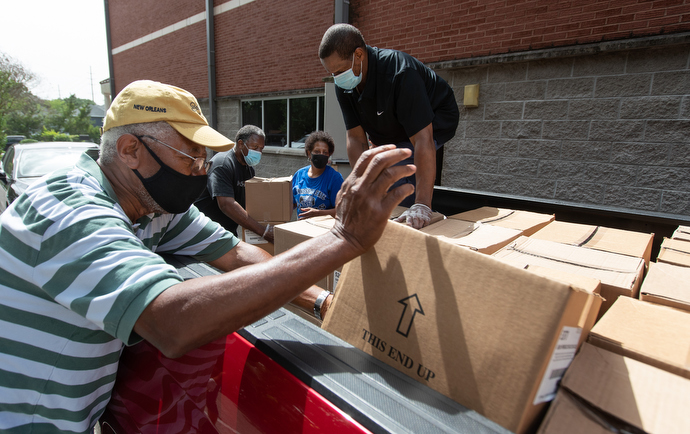 Volunteers unload boxes of produce donated through the Society of St. Andrew at Gordon Memorial United Methodist Church in Nashville, Tenn. The food will be used in the church's food security ministries with seniors and persons experiencing homelessness. From left are: Cliff Steger, Julius Mitchell, Sandra Ragin-Haddock and Richard Wilson. Photo by Mike DuBose, UM News.