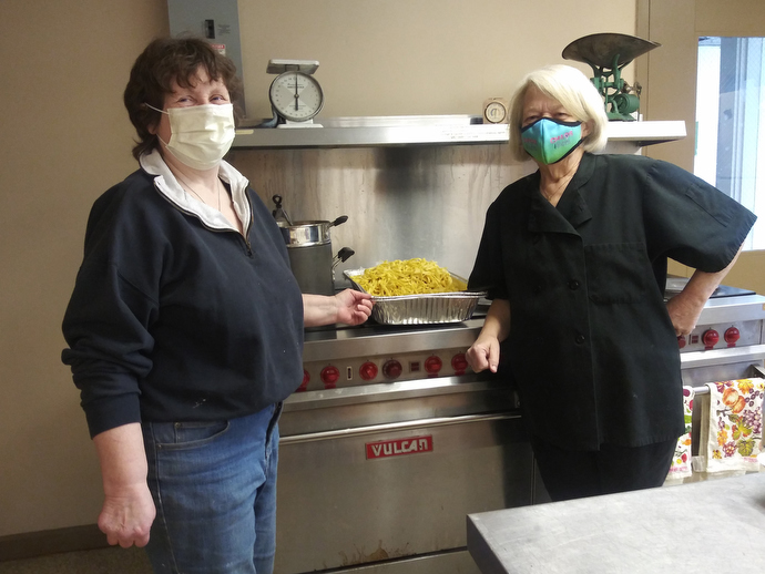 Diana Palmer (left) is the chef and Deb Cappazolli the baker for the community meal service started at First United Methodist Church in Framingham, Mass., to assist during the COVID-19 pandemic. Palmer, a long-time chef and chef manager, created the project, which received a Sheltering in Love grant from the United Methodist Committee on Relief. Photo courtesy of Diana Palmer.