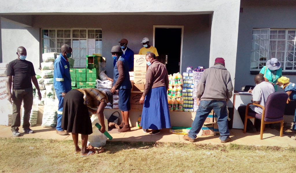 The Nyadire Social Committee distributes food to families at The United Methodist Church's Nyadire Mission in Mutoko, Zimbabwe. The Nyadire Connection, an all-volunteer group founded by individuals from a network of United Methodist churches in Pittsburgh, raised more than $25,000 for food relief at the mission. Photo by Kudzai Chingwe, UM News.