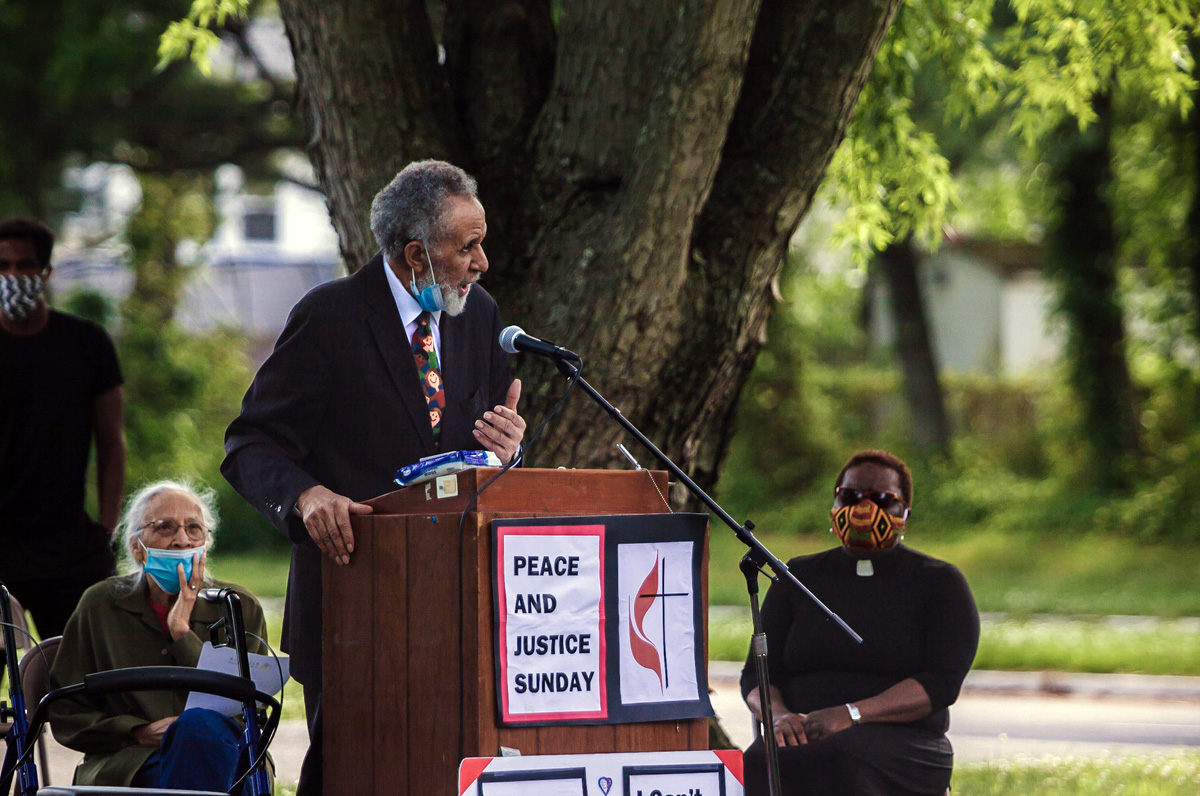 The Rev. Gilbert Caldwell, a retired United Methodist pastor and civil rights activist who marched alongside the Rev. Martin Luther King Jr., speaks during a Black Lives Matter rally June 7 in Willingboro, N.J. To Caldwell's right is his wife, Grace Caldwell. To Caldwell's left is the Rev. Vanessa Wilson, chairperson of the Greater New Jersey Commission on Race and Religion and pastor of Good Shepherd United Methodist Church in Willingboro. The protest was one of many taking place in the U.S. in smaller cities and towns involving United Methodists. Photo by Aaron Wilson Watson.